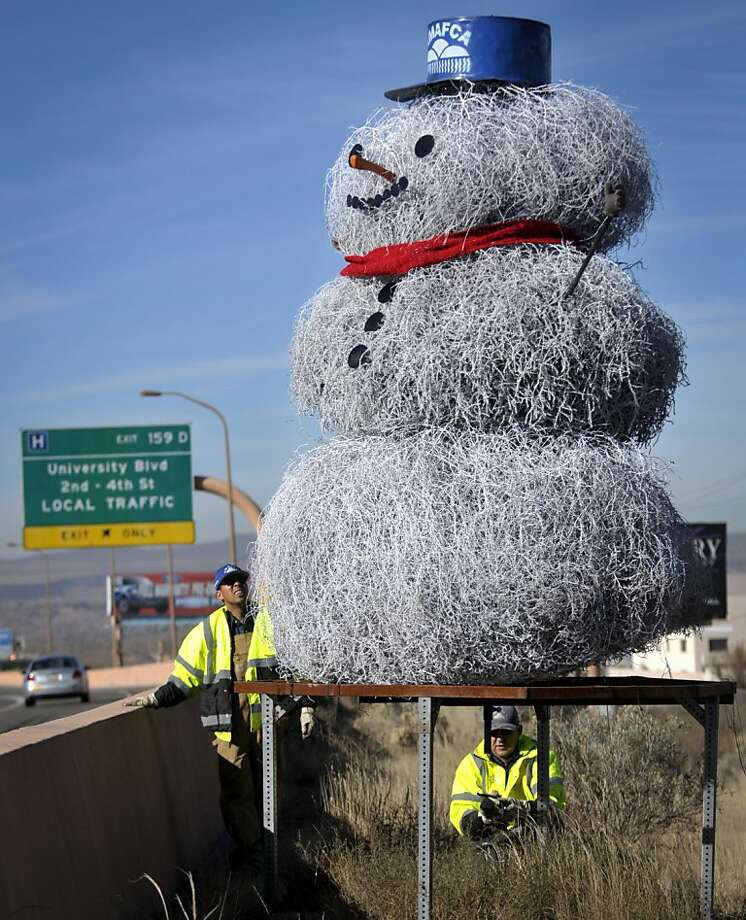 They never melt, they just blow away:It DOES snow in Albuquerque, just not that much. Which is probably why   they build snowmen out of tumbleweeds there. Photo: Marla Brose, Associated Press