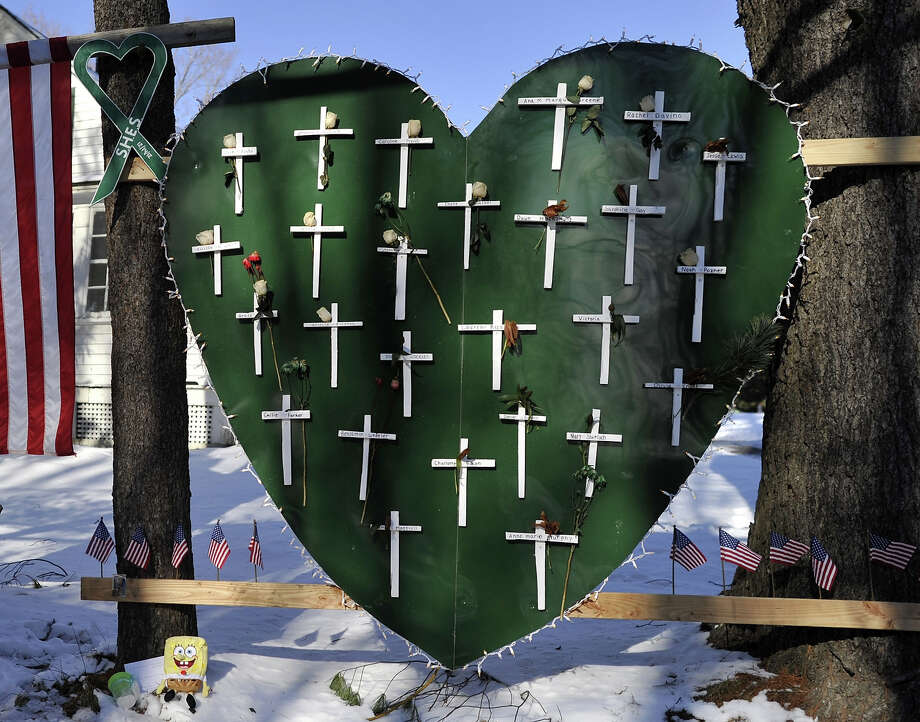 Some of the remaining memorial items to  Sandy Hook Elementary students and staff who died are viewed in Newtown, Connecticut on January 3, 2013. Photo: TIMOTHY A. CLARY, AFP/Getty Images / 2013 AFP