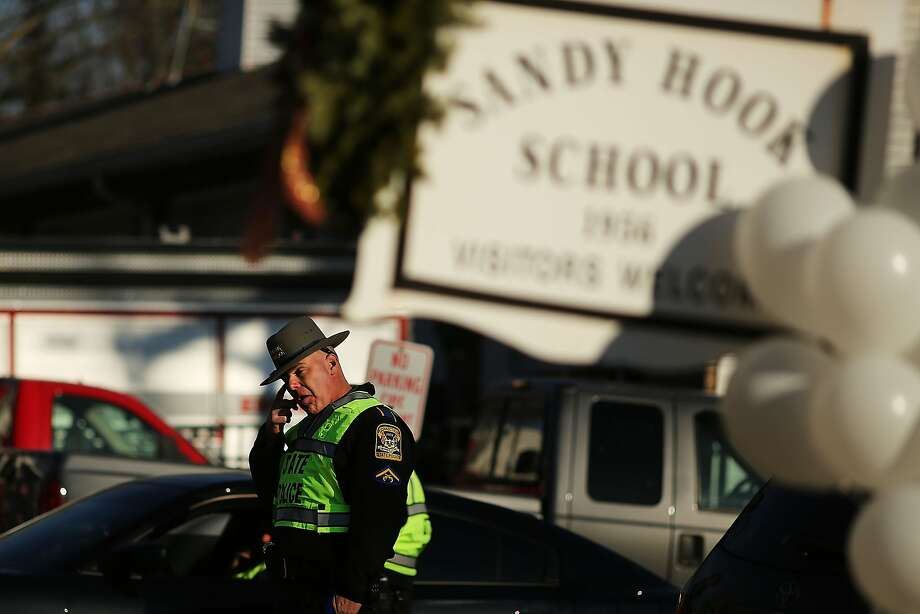 FILE - DECEMBER 4:  The 911 call recordings from the Sandy Hook Elementary School shooting were posted on a town website after a court ordered the release of the tapes December 4, 2013.  NEWTOWN, CT - DECEMBER 15:  A police officer stands outside of the entrance to the Sandy Hook School on December 15, 2012 in Newtown, Connecticut. Twenty six people were shot dead, including twenty children, after a gunman identified as Adam Lanza opened fire at Sandy Hook Elementary School. Lanza also reportedly had committed suicide at the scene. A 28th person, believed to be Nancy Lanza was found dead in a house in town, was also believed to have been shot by Adam Lanza.  (Photo by Spencer Platt/Getty Images) Photo: Spencer Platt, Getty Images