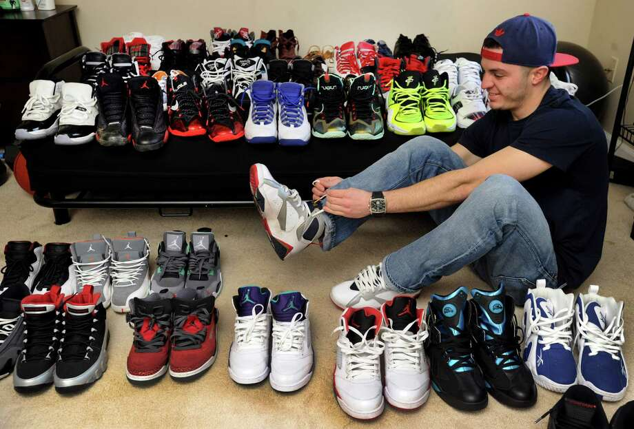 Steven Vazquez, 23, of Danbury, Conn., with some of the over 40 pairs of sneakers he owns, Wednesday, Dec. 4, 2013. Photo: Carol Kaliff / The News-Times