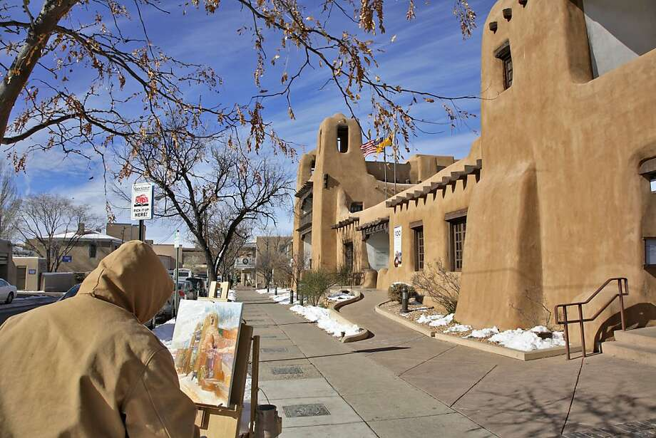An artist works on a painting of the New Mexico Museum of Art in Santa Fe. The city of 69,000 is known for its art galleries and museums. Photo: Herva Gyssels, Getty Images