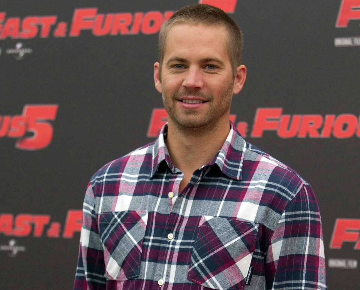 """FILE - In this April 29, 2011 file photo, actor Paul Walker poses during the photo call of the movie """"Fast and Furious 5,"""" in Rome. Universal Pictures has shut down production on """"Fast & Furious 7"""" indefinitely following the death of its star, Walker. The studio announced Wednesday, Dec. 4, 2013, that the film will shut down """"for a period of time so we can assess all options available to move forward with the franchise."""""""