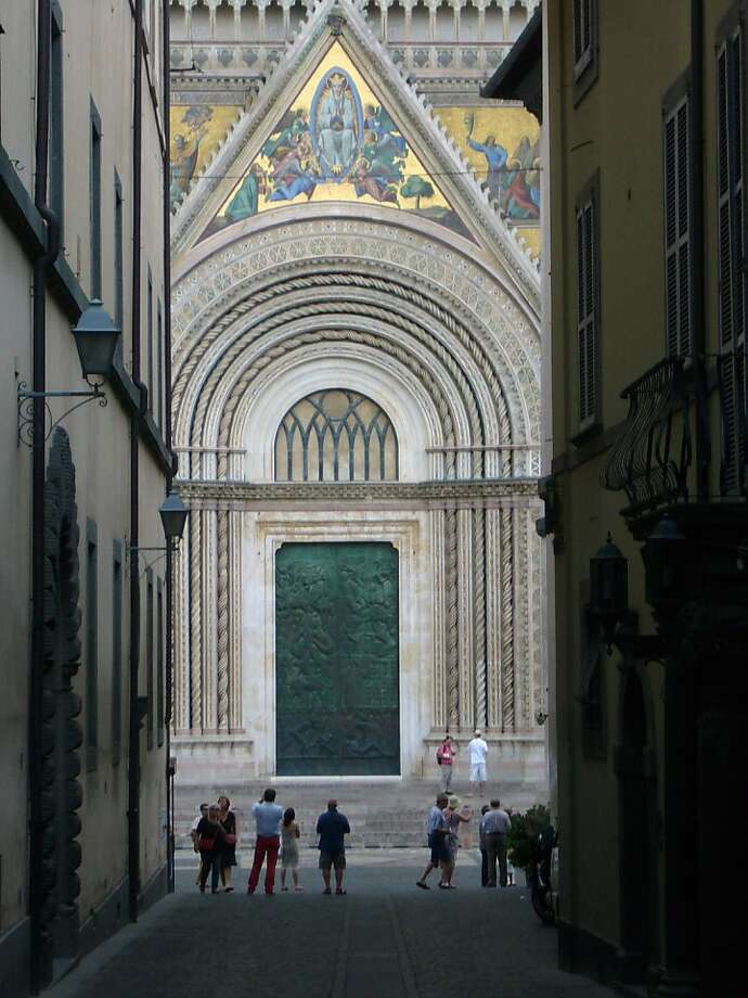 "Orvieto's 14th century cathedral contains the Chapel of San Brizio, which features the ""Day of Judgment"" and ""Life After Death"" frescoes by Luca Signorelli that were studied by Michelangelo. Photo: Scott Norvell, COX"