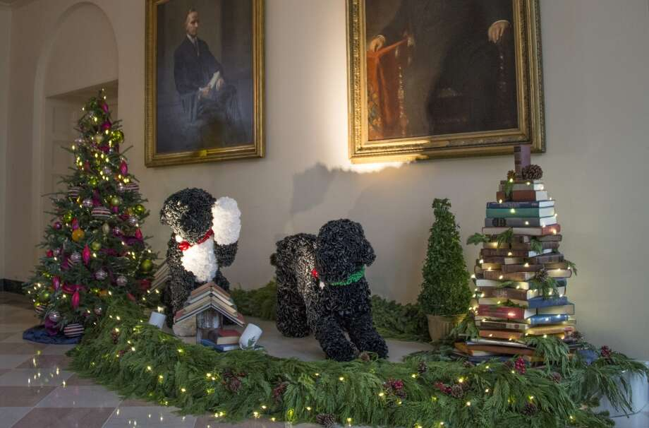 Decorations of the Obama's dogs Bo and Sunny are posed in the East Garden Room at the White House in Washington, DC, December 4, 2013 during the White House Christmas decorations viewing. Photo: JIM WATSON, AFP/Getty Images
