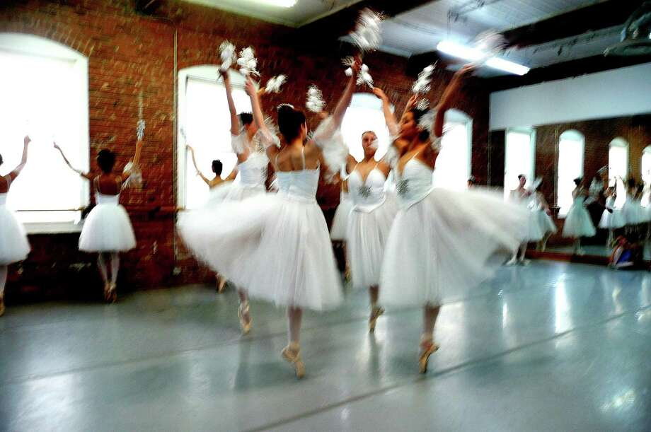 "Senior dancers of the Greenwich Ballet Academy are a blur as they practice a sequence of the ""Waltz of the Snow Flakes,"" during a recent dress rehearsal for the GBA's annual performances of ""The Nutcracker,"" which will take place this weekend. Photo: Anne W. Semmes / Greenwich Citizen"