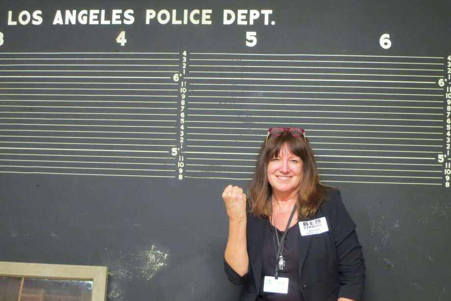 "Getting arrested L.A.-style...on the set of '40s-set TV drama ""Mob City."" Photo: Courtesy"