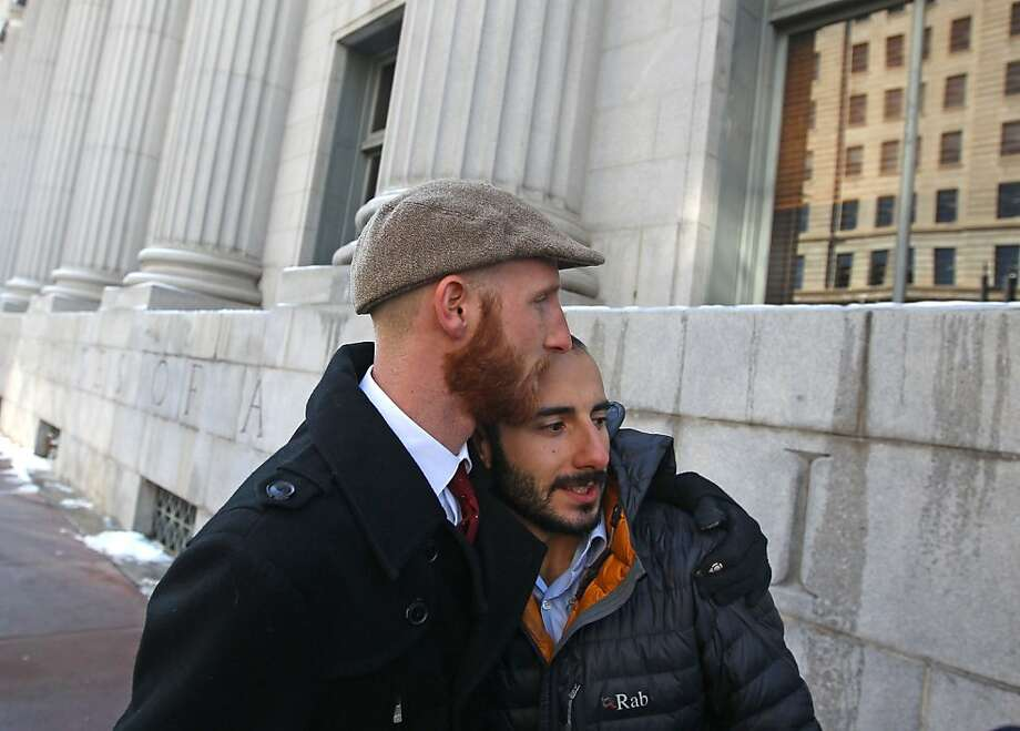 Derek Kitchen (left) and his partner, Moudi Sbeity, leave the federal courthouse in Salt Lake City after a hearing. They are plaintiffs in the challenge to Utah's ban on same-sex marriage. Photo: Rick Bowmer, Associated Press