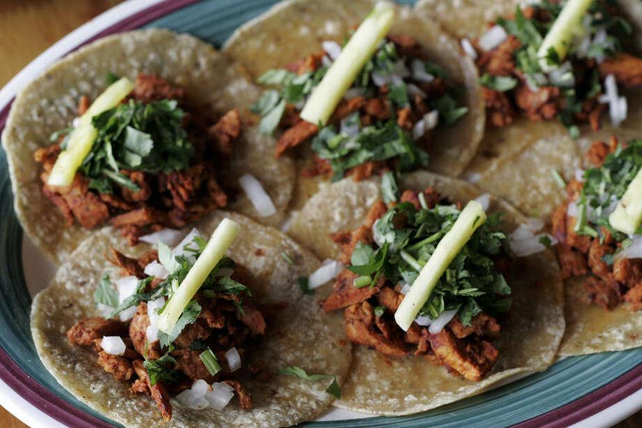 Tacos al Pastor is a menu favorite at Guajillo's, 1001 NW Loop 410. Photo: Express-News File Photo