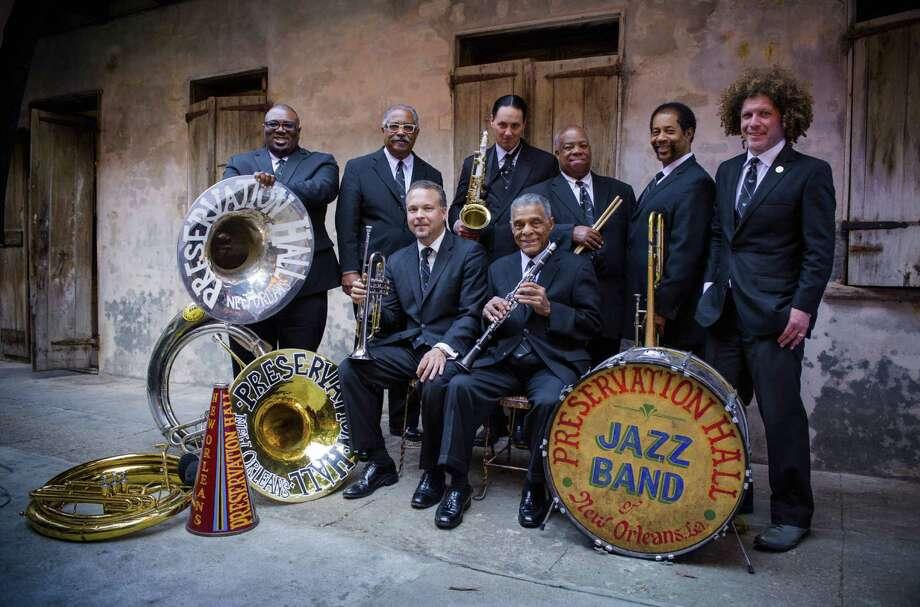 "Preservations Hall Jazz Band - Ronell Johnson (from left), Rickie Monie, Mark Braud, Clint Maedgen, Charlie Gabriel, Joseph Lastle Jr., Freddie Lozano, Ben Jaffe - is celebrating ""Creole Christmas."""