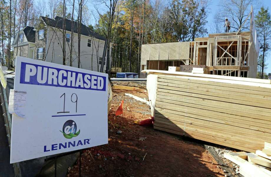 In this Thursday, Nov. 14, 2013,  photo, Workers frame a home under construction in Matthews, N.C., Thursday, Nov. 14, 2013. The Commerce Department reports on new-home sales for October on Wednesday, Dec. 4, 2013. (AP Photo/Chuck Burton) ORG XMIT: NYBZ139 Photo: Chuck Burton / AP