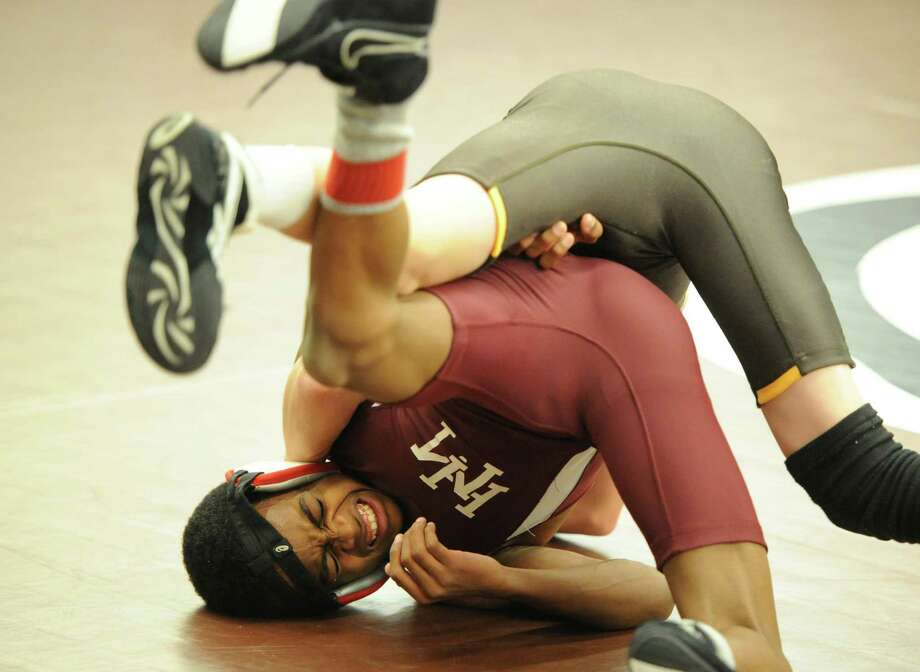 106 pound weight class match between Andrew Hennessey, top, of Brunswick and Leo Humber- Henriquez, bottom, of Horace Mann, during Brunswick School vs. Horace Mann School in high school wrestling at Brunswick in Greenwich, Wednesday, Dec. 4, 2013. Hennessey won the match. Photo: Bob Luckey / Greenwich Time