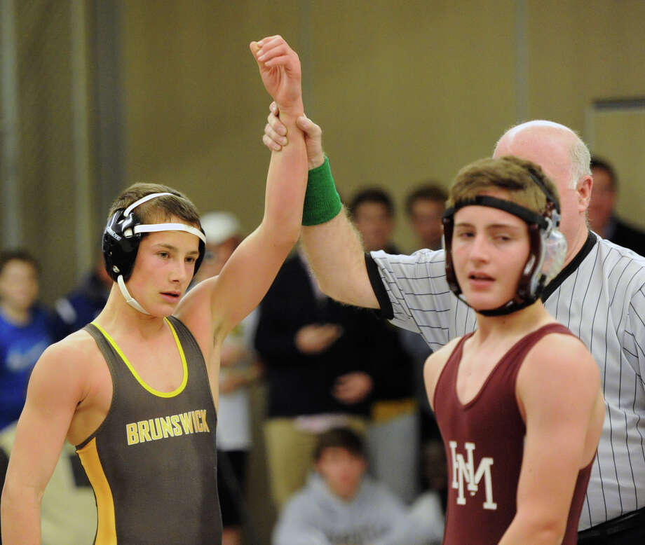 126 pound weight class match between Jack Jones, left, of Brunswick, who was declared the winner over Mason Roth (gray head gear) of Horace Mann during Brunswick School vs. Horace Mann School in high school wrestling at Brunswick in Greenwich, Wednesday, Dec. 4, 2013. Jones pinned Roth for the win. Photo: Bob Luckey / Greenwich Time