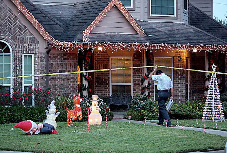 The Brazoria County Sheriff's Office investigates the shooting in the 2400 block of Woodbury on Wednesday. Photo: Thomas B. Shea, Houston Chronicle / © 2013 Thomas B. Shea