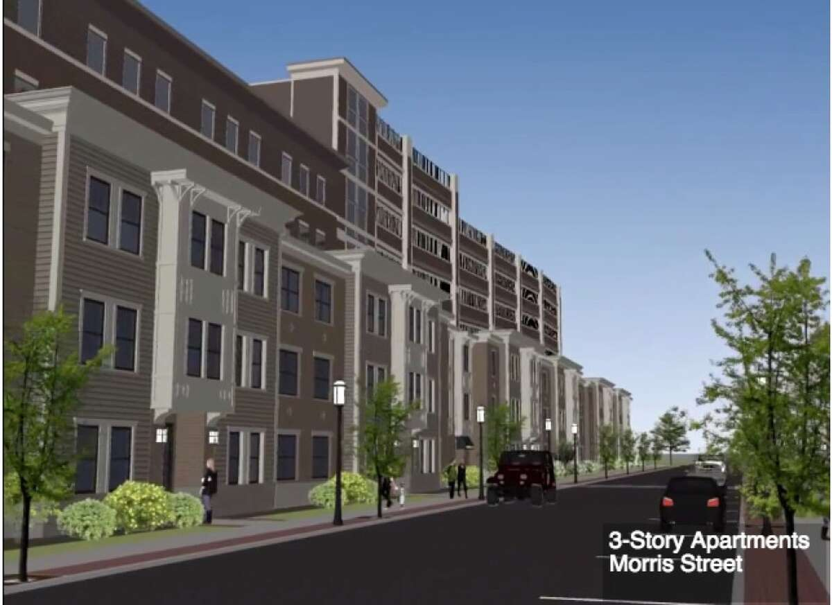 Architect's rendering of apartments and a parking garage planned for the Park South section of Albany. Some residents say the eight-story, 855-space garage is far too big for the area.