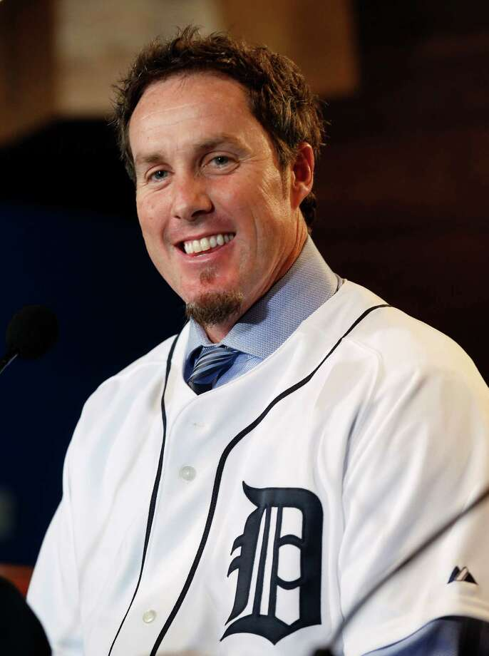 Detroit Tigers pitcher Joe Nathan smiles after being introduced at a news conference in Detroit Wednesday, Dec. 4, 2013.  The Detroit Tigers agreed to terms with free agent reliever Joe Nathan on a two-year contract with a club option for 2016 on Wednesday.  (AP Photo/Paul Sancya) ORG XMIT: MIPS101 Photo: Paul Sancya / AP