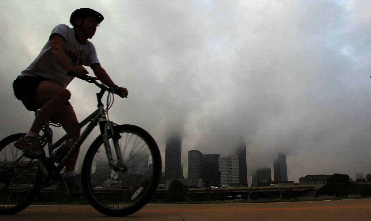 An unidentified cyclist peddles through the White Oak bike trail during a foggy morning on Wednesday, Dec. 4, 2013, in Houston. Temperatures will be in the low 80's and partly cloudy today.