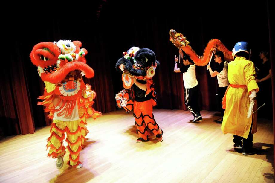 Members of the UAlbany Chinese Students and Scholars Association perform a Chinese Lion and Dragon Dance during the UAlbany Confucius Institute Inauguration Ceremony on Wednesday, Dec. 4, 2013, at the University at Albany in Albany, N.Y. (Cindy Schultz / Times Union) Photo: Cindy Schultz / 00024865A