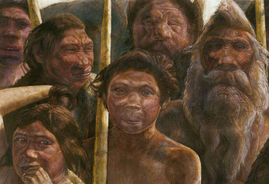 This artist's rendering provided by Madrid Scientific Films in December 2013 shows Sima de los Huesos hominins who are estimated to have lived approximately 400,000 years ago during the Middle Pleistocene. Scientists have reached farther back than ever into the ancestry of humans to recover and analyze DNA, with a sample from a bone from a site in Sima de los Huesos, Spain. So far, the achievement has provided more questions than answers about the human family tree. Results were presented online Wednesday, Dec. 4, 2013 in the journal Nature by Matthias Meyer and colleagues at the Max Planck Institute for Evolutionary Anthropology in Leipzig, Germany, with co-authors in Spain and China. (AP Photo/Madrid Scientific Films, Kennis & Kennis) ORG XMIT: NY501 Photo: Kennis & Kennis / Madrid Scientific Films