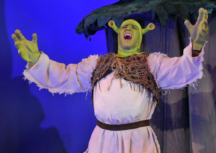 "Bennett Leeds plays Shrek during The Stamford All-School Musical's dress rehearsal performance of ""Shrek the Musical"" at Rippowam Middle School in Stamford, Conn., on Wednesday, Dec. 4, 2013. Opening night is Saturday, Dec. 7 at 7:30 p.m. at Rippowam Middle School, followed by four more performances. For more information go to stamfordallschoolmusical.org. Photo: Jason Rearick / Stamford Advocate"