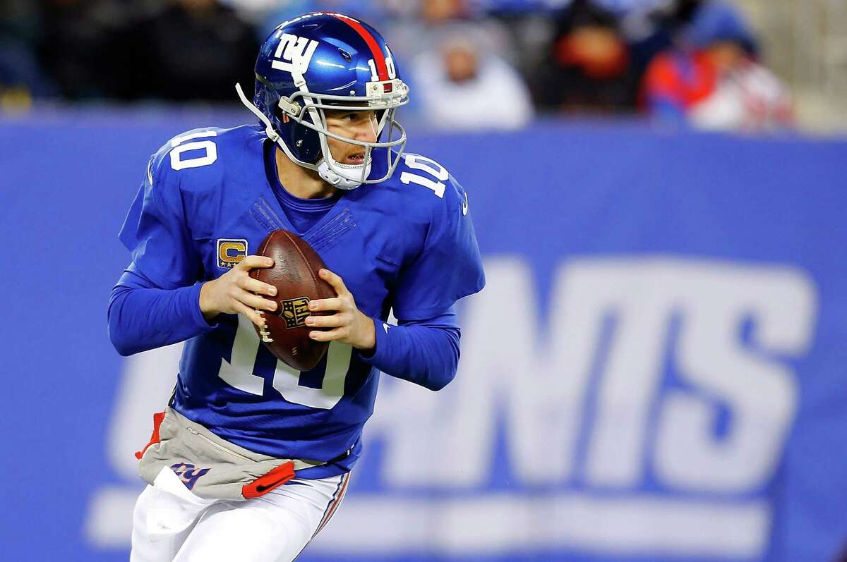 EAST RUTHERFORD, NJ - NOVEMBER 24: (NEW YORK DAILIES OUT) Eli Manning #10 of the New York Giants in action against the Dallas Cowboys on November 24, 2013 at MetLife Stadium in East Rutherford, New Jersey. The Cowboys defeated the Giants 24-21. (Photo by Jim McIsaac/Getty Images) *** Local Caption *** Eli Manning
