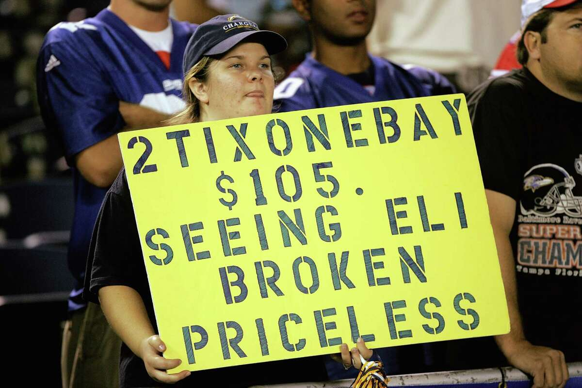 SAN DIEGO - SEPTEMBER 25: A San Diego Chargers fan holds a sign disparaging New York Giants quarterback Eli Manning on September 25, 2005 at Qualcomm Stadium in San Diego, California. The Chargers won 45-23. (Photo by Stephen Dunn/Getty Images)