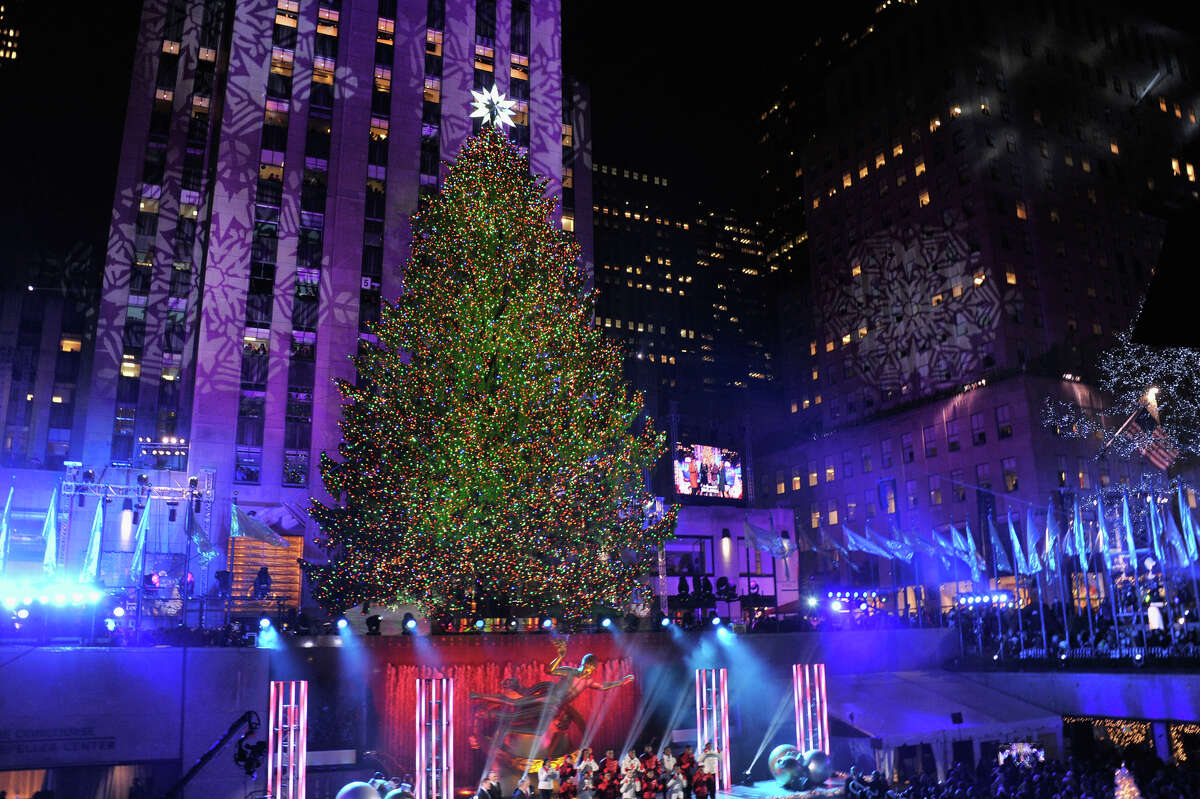 NEW YORK, NY - DECEMBER 04: The Christmas Tree is lit during 81st Annual Rockefeller Center Christmas Tree Lighting Ceremony at Rockefeller Center on December 4, 2013 in New York City.