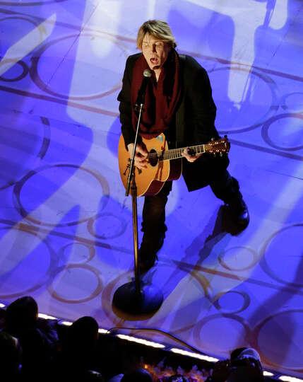 John Rzeznik, lead singer of the Goo Goo Dolls, sings before the lighting of the Rockefeller Center