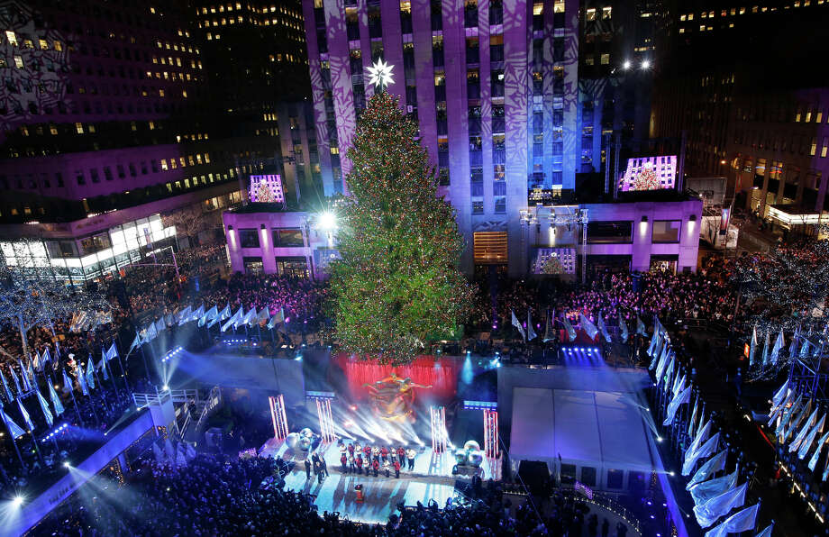 The Rockefeller Center Christmas tree is lit during a ceremony, Wednesday, Dec. 4, 2013, in New York. Some 45,000 energy efficient LED lights adorn the 76-foot tree. Photo: Kathy Willens, AP / Associated Press