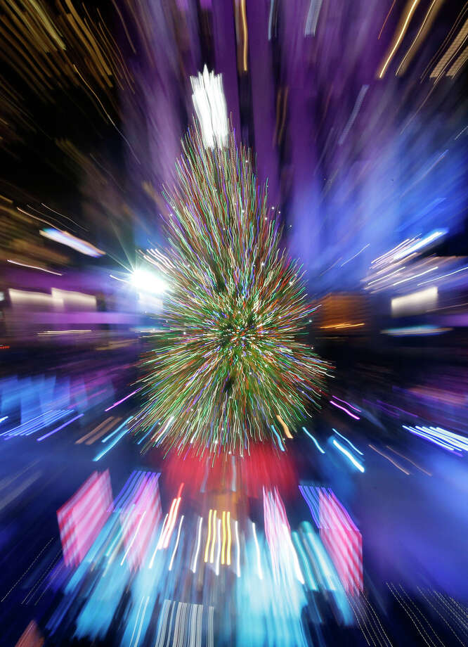 The Rockefeller Center Christmas tree is lit during a ceremony, Wednesday, Dec. 4, 2013, in New York, in this view in which the lens was zoomed during the exposure. Some 45,000 energy efficient LED lights adorn the 76-foot tree. Photo: Kathy Willens, AP / Associated Press