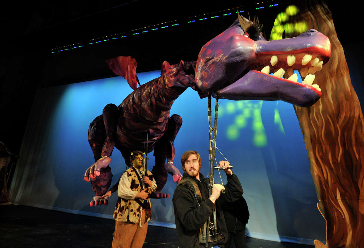 """Puppeteer from Michigan Alex Gibson operates the puppet dragon before the start of The Stamford All-School Musical's dress rehearsal performance of """"Shrek the Musical"""" at Rippowam Middle School in Stamford, Conn., on Wednesday, Dec. 4, 2013. Opening night is Saturday, Dec. 7 at 7:30 p.m. at Rippowam Middle School, followed by four more performances. For more information go to stamfordallschoolmusical.org."""