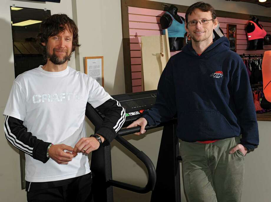 James O'Connor, left, and Jim Sweeney stand with a treadmill in the Fleet Feet Sports store on Wolf Rd. Tuesday, Dec. 3, 2013 in Colonie, N.Y. They will run on a treadmill for 24 hours, starting Friday, in order to break a world record and raise money for the Regional Food Bank of Northeast New York. There will be a few treadmills there for anybody who wishes to participate in the fundraiser. People can sign up to run or walk on the treadmill for 20 minutes or more if they'd like. (Lori Van Buren / Times Union) Photo: Lori Van Buren / 00024863A