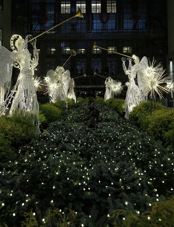 Angels made of wire and lights blow horns in the Rockefeller Center Channel Gardens Wednesday, Dec. 4, 2013, in New York. Photo: Kathy Willens, AP / Associated Press