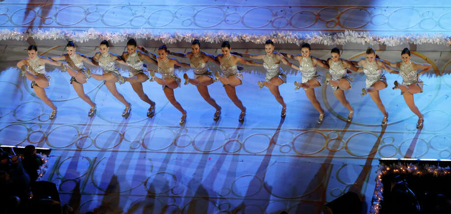 The Rockettes dance on stage before the lighting of the Rockefeller Center Christmas tree, Wednesday, Dec. 4, 2013, in New York. Photo: Kathy Willens, AP / Associated Press