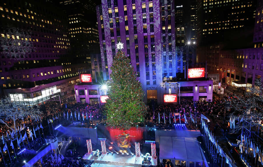 The Rockefeller Center Christmas tree is lit following a ceremony, Wednesday, Dec. 4, 2013, in New York. Some 45,000 energy efficient LED lights adorn the 76-foot tree. Photo: Kathy Willens, AP / Associated Press