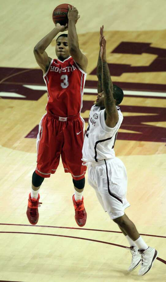 Houston's Jaaron Simmons (3) shoots the ball as Teaxs A&M's Fabyon Harris defends during the second half of an NCAA college basketball game, Wednesday, December 3, 2013, at Reed Arena in College Station, TX. Photo: Eric Christian Smith, For The Chronicle