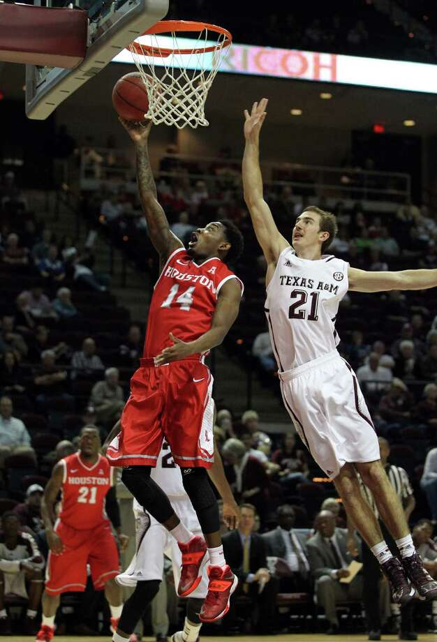 Houston's Tione Womack (14) shoots a layup as Texas A&M's Alex Caruso defends during the first half of an NCAA college basketball game, Wednesday, December 3, 2013, at Reed Arena in College Station, TX. Photo: Eric Christian Smith, For The Chronicle