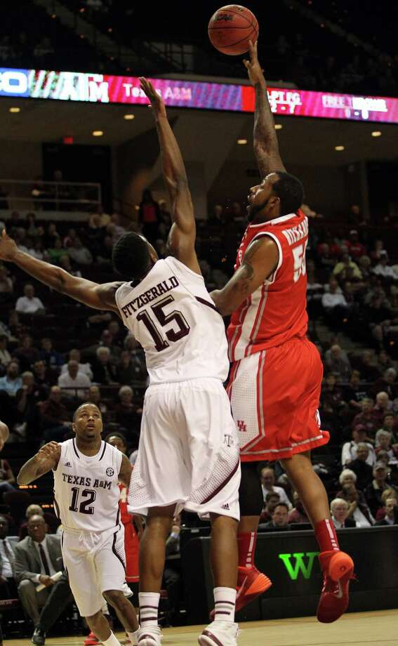 Houston's J.J. Richardson, right, shoots over Texas A&M's Davonye Fitzgerald during the first half of an NCAA college basketball game, Wednesday, December 3, 2013, at Reed Arena in College Station, TX. Photo: Eric Christian Smith, For The Chronicle