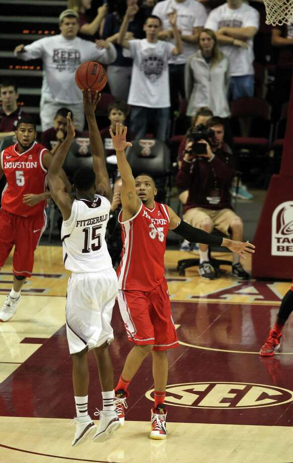 Texas A&M's Davonte Fitzgerald (15) shoots over Houston's TaShawn Thomas during the second half of an NCAA college basketball game, Wednesday, December 3, 2013, at Reed Arena in College Station, TX. Photo: Eric Christian Smith, For The Chronicle