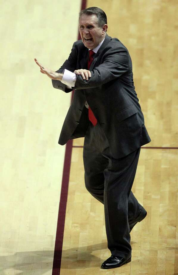 Houston head coach James Dickey yells from the bench during the second half of an NCAA college basketball game against Texas A&M, Wednesday, December 3, 2013, at Reed Arena in College Station, TX. Photo: Eric Christian Smith, For The Chronicle