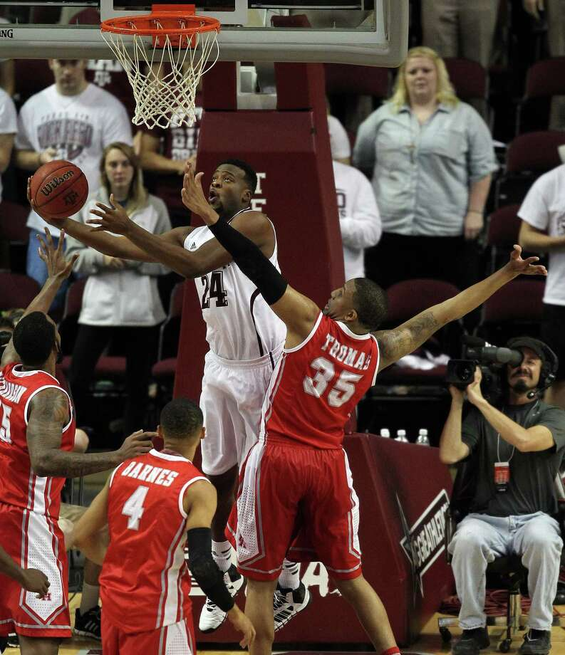 Texas A&M's Antwan Space, left, shoots the ball as Houston's TaShawn Thomas defends during the second half of an NCAA college basketball game, Wednesday, December 3, 2013, at Reed Arena in College Station, TX. Photo: Eric Christian Smith, For The Chronicle
