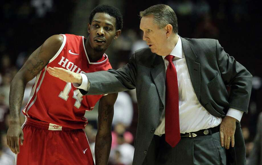 Houston head coach James Dickey, right, gives instructions to Tione Womack during the second half of an NCAA college basketball game, Wednesday, December 3, 2013, at Reed Arena in College Station, TX. Photo: Eric Christian Smith, For The Chronicle