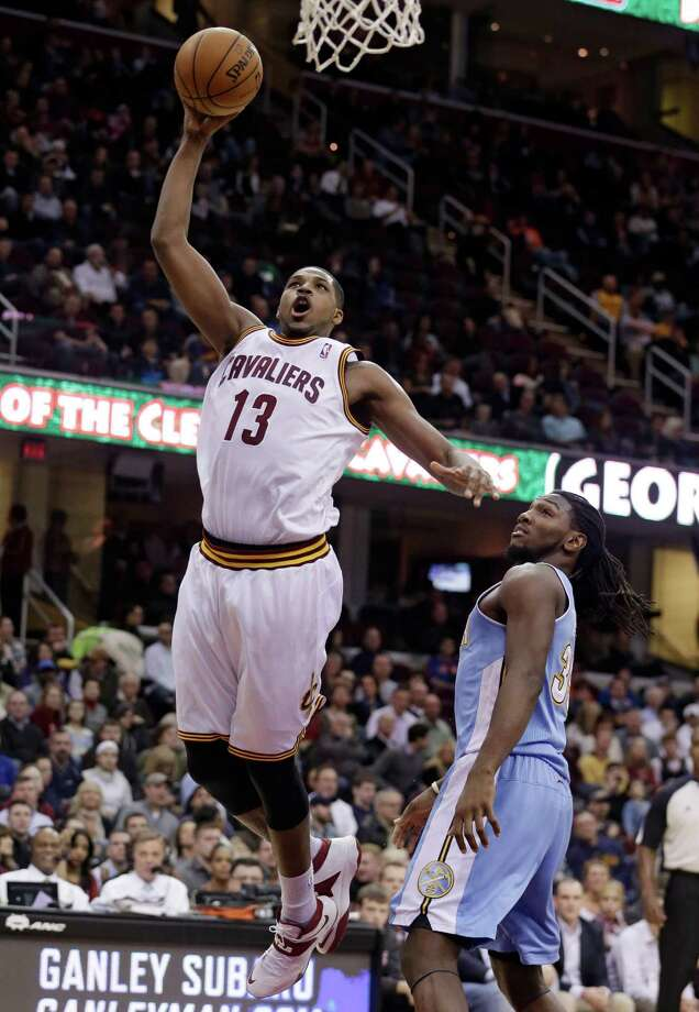 Cleveland Cavaliers' Tristan Thompson (13), from Canada, jumps to the basket against Denver Nuggets' Kenneth Faried (35) during the second quarter of an NBA basketball game on Wednesday, Dec. 4, 2013, in Cleveland. (AP Photo/Tony Dejak) ORG XMIT: OHTD108 Photo: Tony Dejak / AP