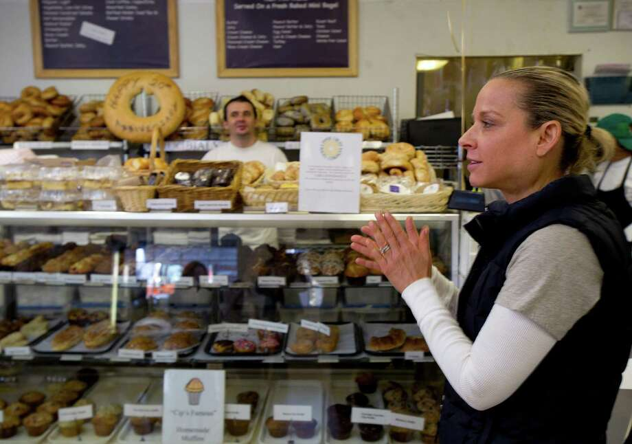 Amy Guerrieri speaks as Upper Crust Bagel Company in Greenwich, Conn., celebrates its 20th birthday at 197 Sound Beach Ave. on Wednesday, December 4, 2013. Photo: Lindsay Perry / Stamford Advocate