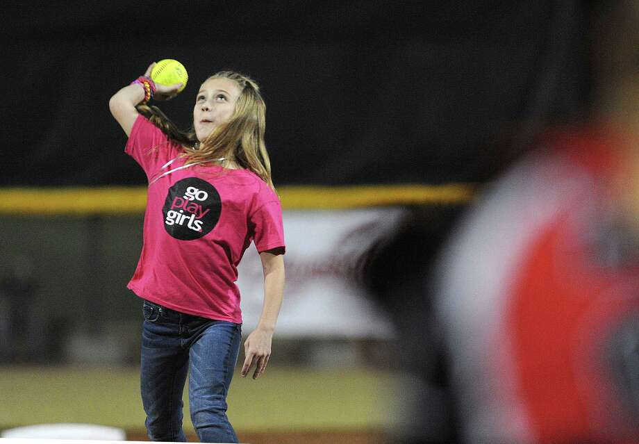 Patton Taylor, a girl who suffers from childhood arthritis, throws out the first pitch before the game between the National Professional Fastpitch League 2013 champions, The Pride, and the Alamo City Defenders, a team of former college and pro players with Texas connections, at The Park at St. Mary's University on Wednesday, Dec. 4, 2013. Photo: Billy Calzada, San Antonio Express-News / San Antonio Express-News