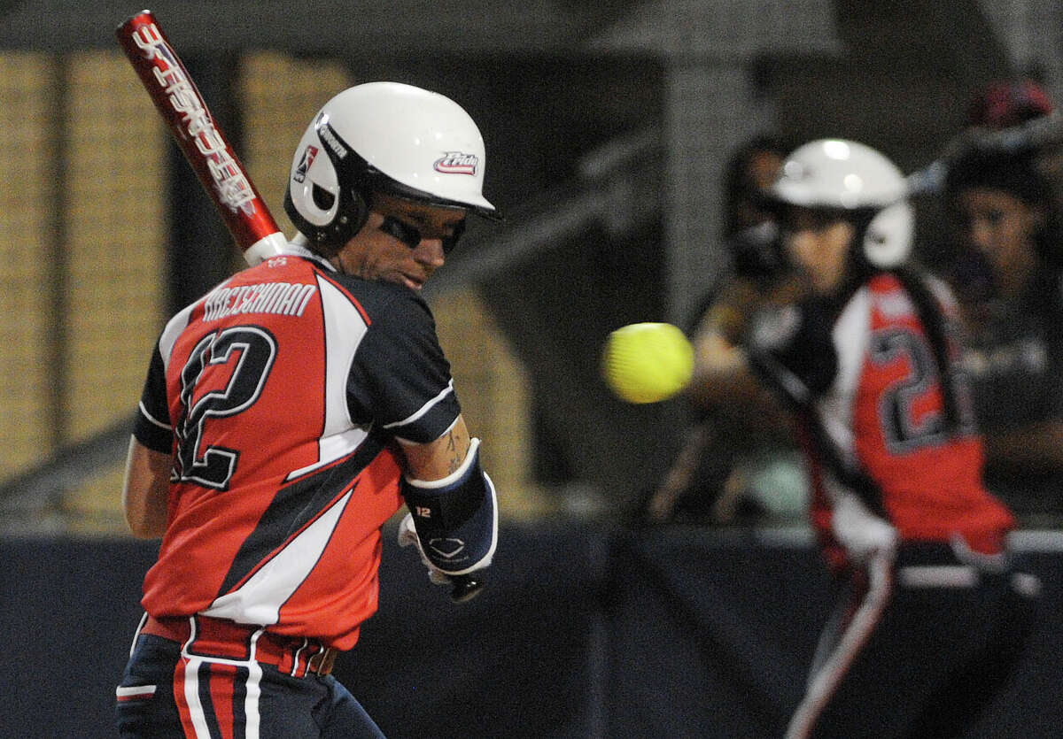 Kelly Kretschman of The Pride evades an inside pitch during softball action against the Alamo City Defenders at the Park at St. Mary's University on Wednesday, Dec. 4, 2013.
