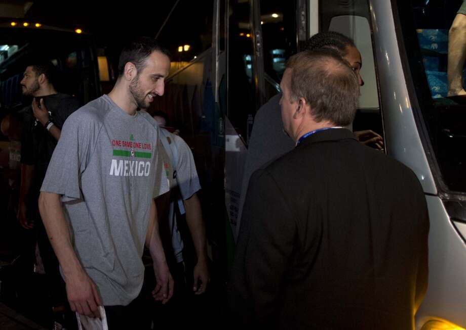 San Antonio Spurs player Manu Ginobili leaves the Arena Ciudad de Mexico after the cancellation the NBA between the San Antonio Spurs and Minnesota Timberwolves, in Mexico City on December 4, 2013.  NBA stars were evacuated from a Mexico City arena Wednesday after a transformer burned and spread smoke on the court before a game between the San Antonio Spurs and Minnesota Timberwolves. Players abandoned their warm-up and exited the 22,000-capacity facility about an hour before tip-off, an AFP photographer said, adding that the stands were empty at the time.    AFP PHOTO / RONALDO SCHEMIDTRONALDO SCHEMIDT/AFP/Getty Images Photo: RONALDO SCHEMIDT, AFP/Getty Images