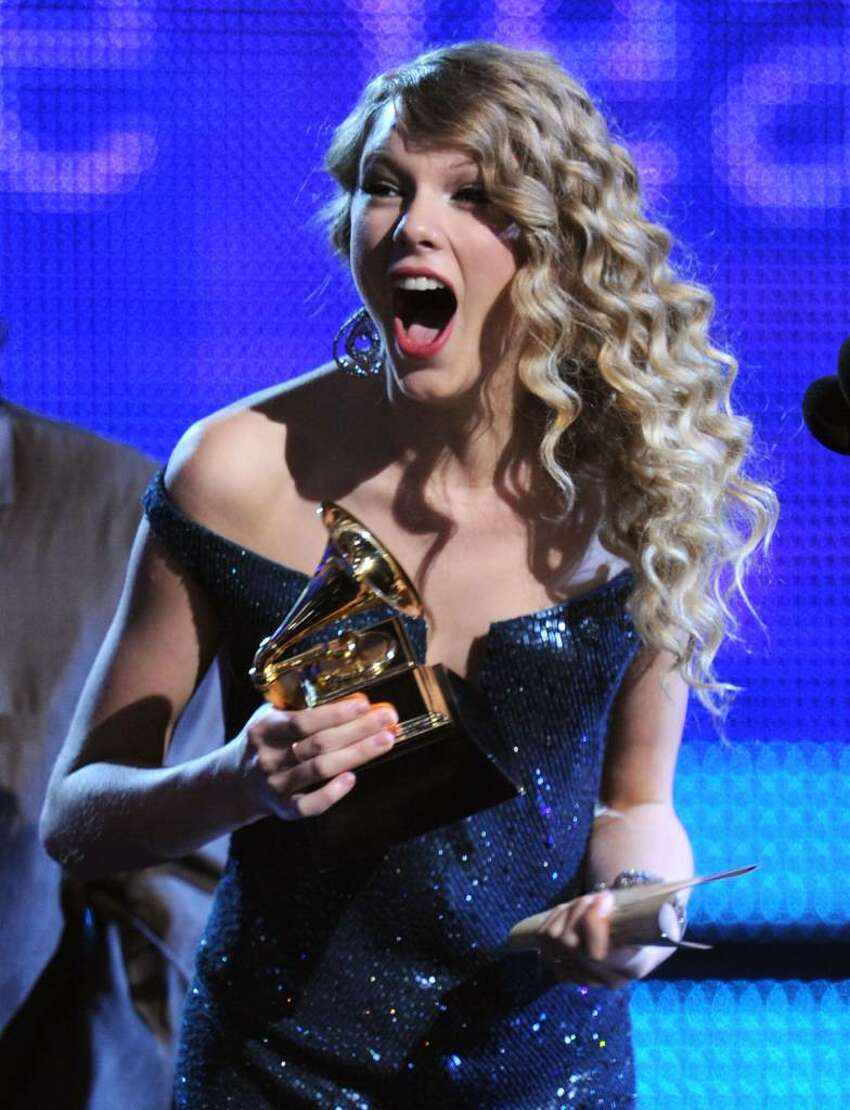 LOS ANGELES, CA - JANUARY 31: Singer Taylor Swift accepts the Album Of The Year award onstage during the 52nd Annual GRAMMY Awards held at Staples Center on January 31, 2010 in Los Angeles, California. (Photo by Kevin Winter/Getty Images) *** Local Caption *** Taylor Swift