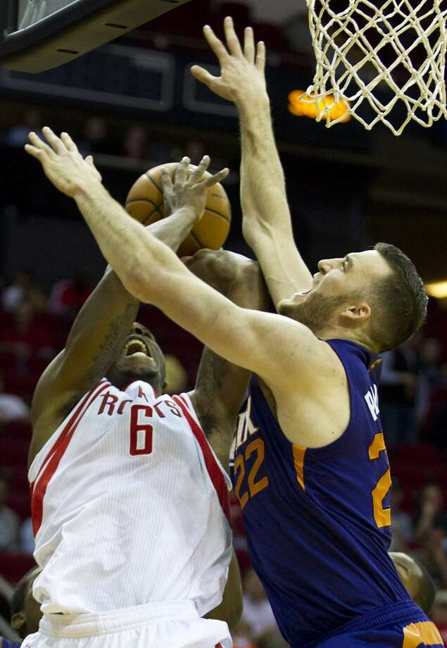 Dec. 4: Suns 97, Rockets 88  Rockets power forward Terrence Jones (6) is fouled by Suns center Miles Plumlee (22) as he goes to the basket. Photo: Brett Coomer, Houston Chronicle