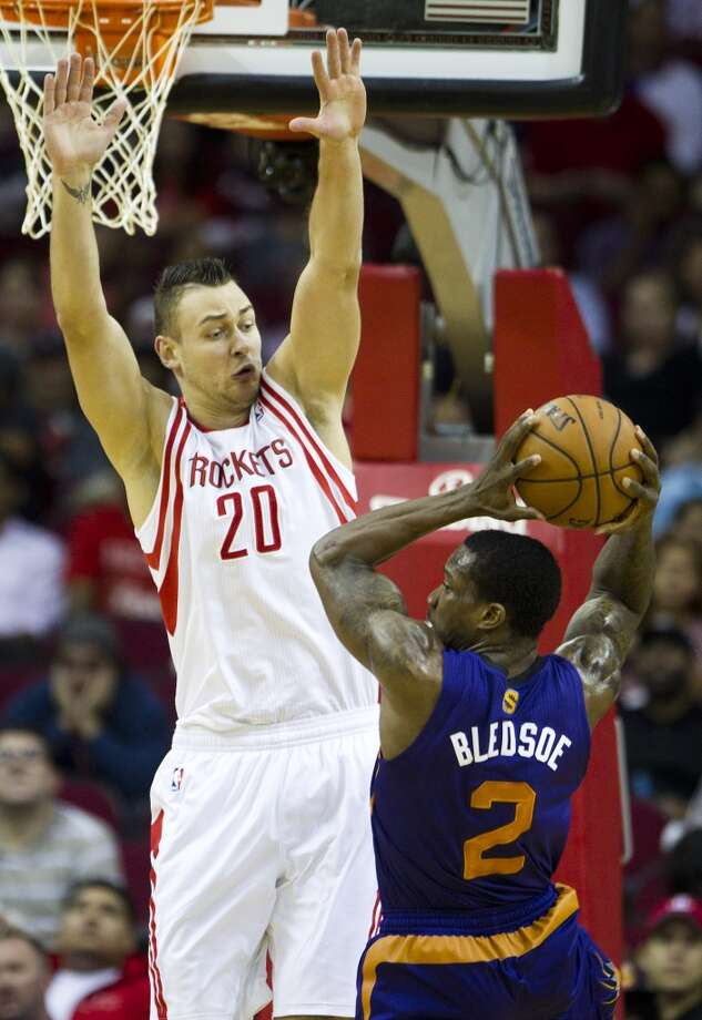 Rockets power forward Donatas Motiejunas (20) defends a shot by Suns point guard Eric Bledsoe (2). Photo: Brett Coomer, Houston Chronicle
