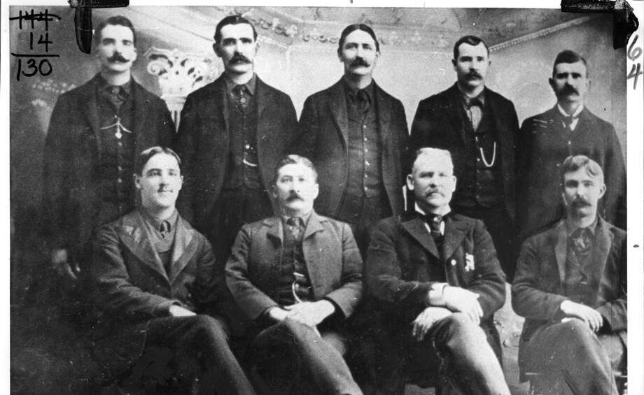 """1902: The SFPD Chinatown squad. I'm getting a strong """"Deadwood"""" vibe from this crew. Also, more pocket watch chains than the current force. Note the 88% mustache compliance. The guy on the bottom left must be a new recruit. Photo: Chronicle File"""